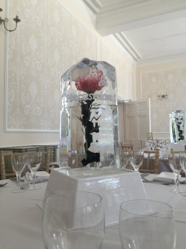 Tall table Centre - Pincussion Protea with cascading ribbon and engraved celtic swirls