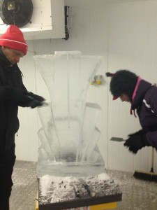 Kelly & Mike carving their own ice sculpture.
