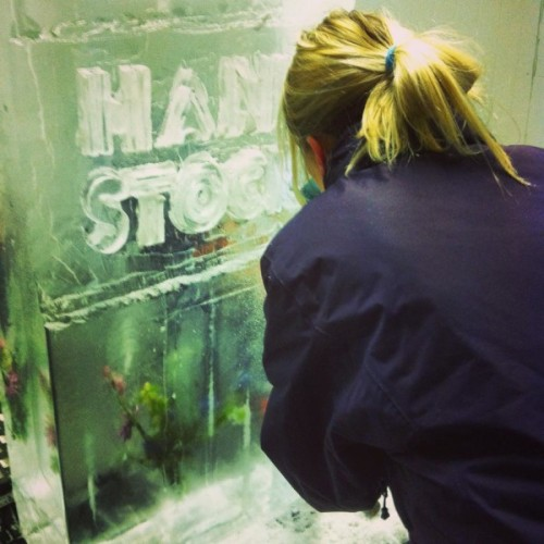 Carving their own ice sculpture.