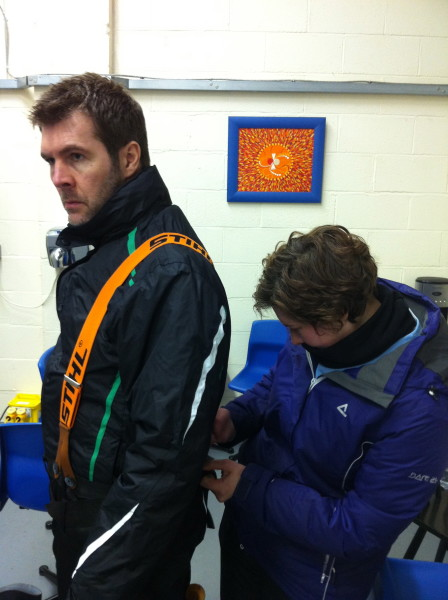 Laura helps Rhod get kitted up for sculpting in the freezer