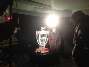 Dot Davies filming a link to Sport Wales with our ice sculpture of the Premier League trophy.