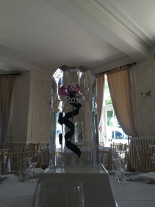 Rose suspended in ice with engraved celtic swirls and cascading ribbon