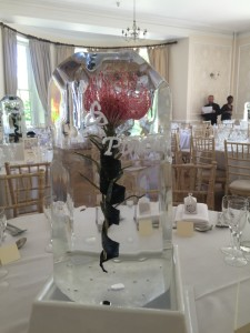 Pincussion Protea suspended in ice with engraved Celtic swirls and cascading ribbon